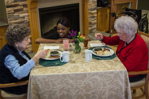 Woodbury Dining staff converse with patients