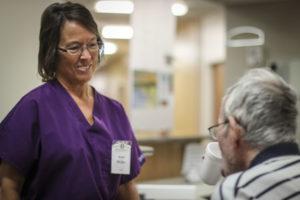 Nurse speaking with elderly man
