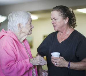 Caretaker talking with paitient at Woodbury